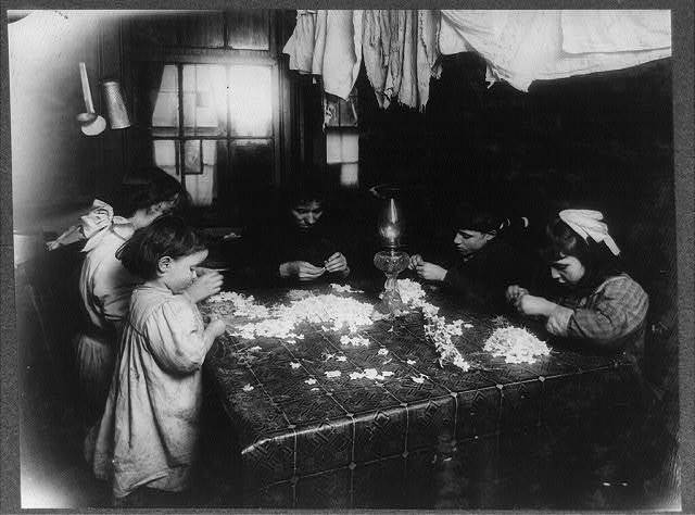 This is the condition in which I found the lower hall at 266 Elizabeth St., N.Y. 3:00 P.M., February 2, 1912. It is a licensed tenement and finishing of clothes was going on in the homes.  Location: New York, New York (State)