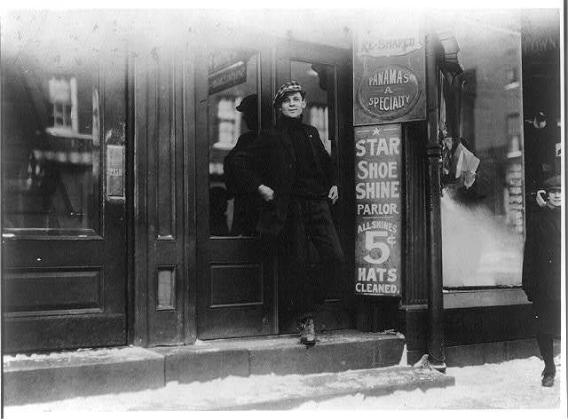 Thomas Parsomidis, Shoe Shinning [i.e., Shining] Parlor, 8 North Main St. Boy said business is bad. Place closed most of the time. He and another own the shop.  Location: Fall River, Massachusetts.
