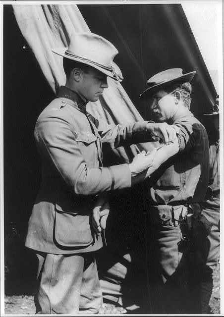 [U.S. Army medical officer vaccinating soldier with arm injection, San Antonio, Texas]