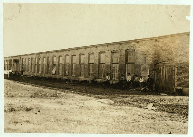 Where it happened. (See photos 3070 to 3074), Sanders Cotton Mfg. Co., Bessemer City, N.C. In this and the adjoining mill (run by the same company) there were still many dangerous, unprotected gears, belts, belts running through the open floor, rough broken flooring on which the workers would likely stumble, etc.- when I went through these mills (October 23rd, 1912) over two months after the accident.  Location: Bessemer City, North Carolina.