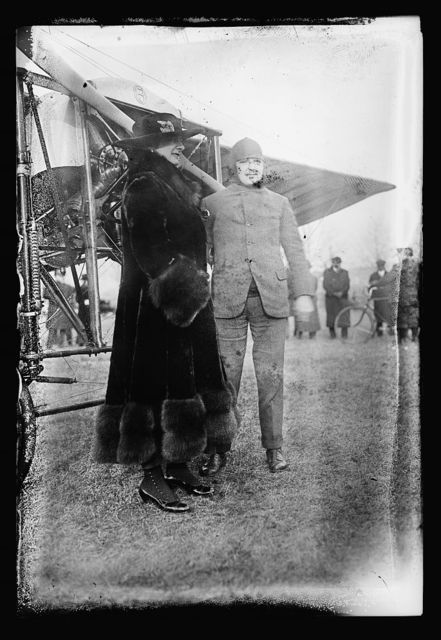 [Woman and man next to airplane]