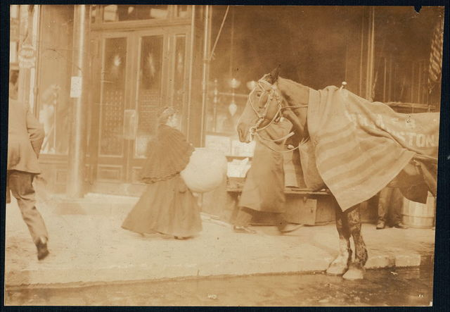 Woman carrying corset covers made on Macdougal St. to factory, 171 Wooster Street, N.Y.  Location: New York, New York (State)