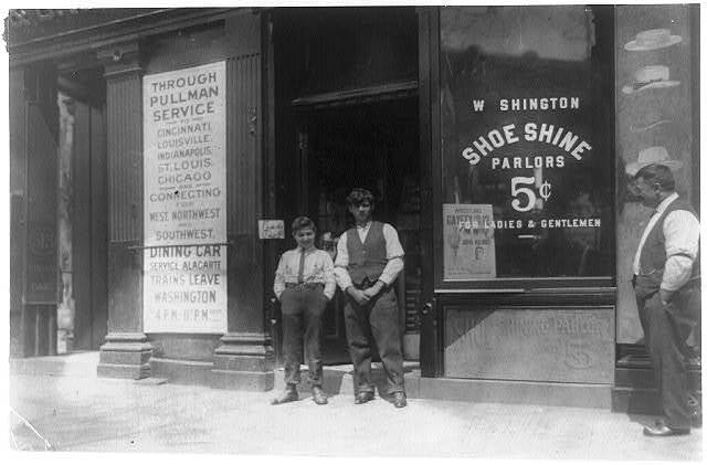 Young boy is Ciriakos Keiradimos, a young Greek shoe-shiner, working in shop at 511 Penn. Ave., N.W., Washington, D.C. Said to be 16 yrs. old, but is absolutely illiterate. Has been in this country only 2 months. Works until 9 P.M. every day and until 11 P.M. Saturdays.  Location: Washington (D.C.), District of Columbia.