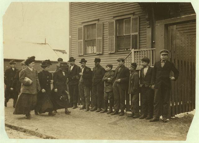 [Young girls running gauntlet of men making remarks (sometimes vile)].  Location: [New Bedford, Massachusetts]
