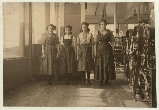 Young spinners in Cornell Mill. Posed by boss.  Location: Fall River, Massachusetts.