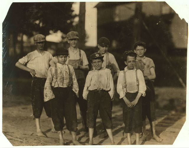 Young workers going home from the Beaumont Mill, Spartenberg [sic], S.C. In the front row are Jesse Farmer, makes 60 cents a day, been working here six months. Haskel Holt, 70 cents a day six months working. A 13 year old sister been spinning his own name.  Location: Spartanburg, South Carolina.