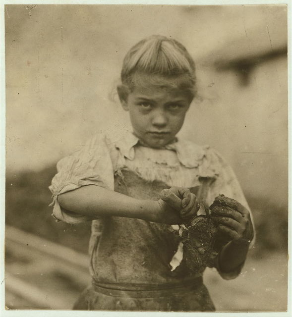 7-year old Rosie. Regular oyster shucker. Her second year at it. Illiterate. Works all day. Shucks only a few pots a day. (Showing process) Varn & Platt Canning Co.  Location: Bluffton, South Carolina.