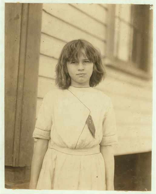 Ada Griffith, a very young spinner in Massachusetts Mills, Lindale, Ga. Runs 4 sides. Apparently under 12.  Location: Lindale, Georgia.