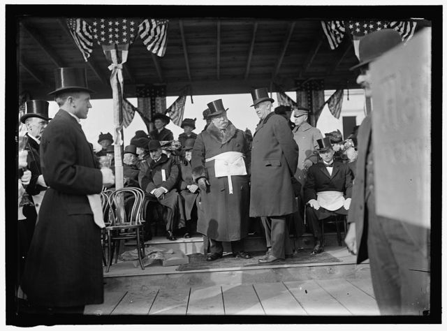 ALL SOULS CHURCH. CEREMONIES AT LAYING OF A CORNERSTONE AT 16TH AND R. CHURCH NOT BUILT THERE, LATER BUILT AT 16TH AND HARVARD ST. SEATED AT RIGHT OF POLE: GEN. WOODHULL; MYRON M. PARKER, PAST GRAND MASTER; BERNARD R. GREEN. STANDING: PRESIDENT TAFT AND THE PRESIDENT OF AMERICAN UNITARIAN