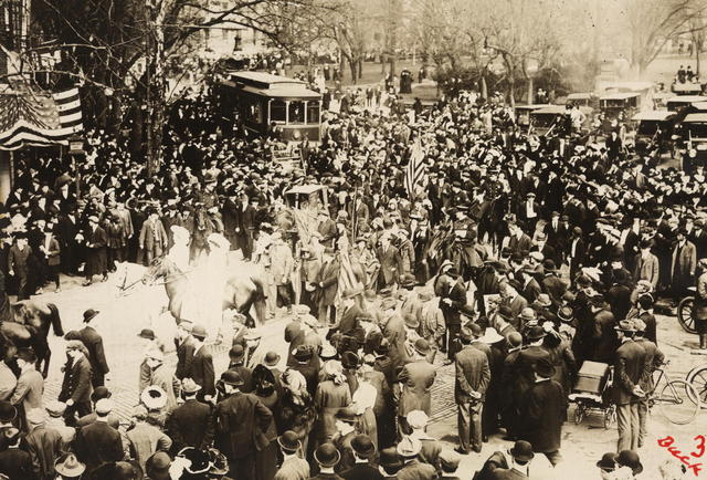Arrival in Washington in March 1913 of Rosalie Jones' band of pilgrims on their trip from New York to the National Capitol to ask President Wilson to give his support to the national woman suffrage amendment. This photograph shows Washington suffragists escorting the pilgrims through the streets of the Capitol.