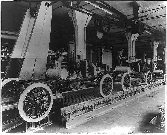 [Assembly line at the Ford Motor Company's Highland Park plant]