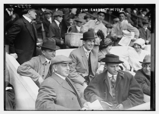 [Boxer Jim Corbett (center) and Blossom Seeley (wife of Rube Marquard) to Corbett's left at Game One of the 1913 World Series at the Polo Grounds New York (baseball)]