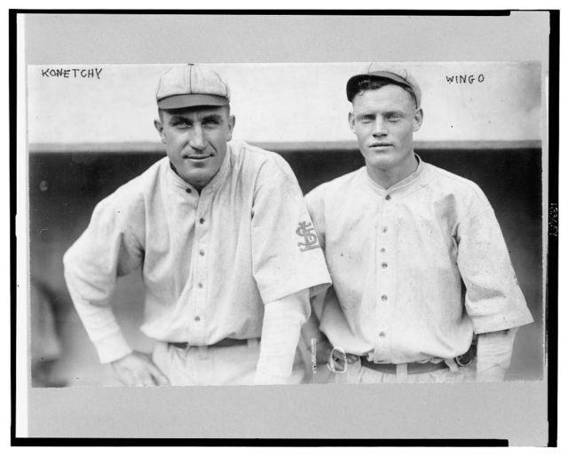 [Ed Konetchy and Ivy Wingo, St. Louis Cardinals baseball players, half-length portrait, standing, facing front, wearing uniforms]