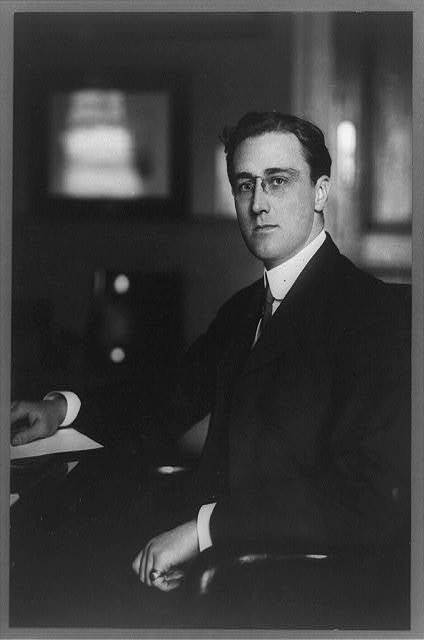 [Franklin Roosevelt, three-quarter length portrait, seated, facing left]