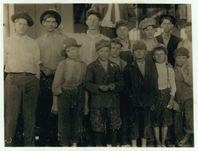 Group of workers in the Massachusetts Mills, Lindale, Ga. Photo taken at noon, April 12, 1913, while they were being paid off. During the days following this, I proved the ages of nearly a dozen of these children, by gaining access to Family Records, Life Insurance papers, and through conversations with the children and parents, and found these that I could prove to be working now, or during the past year at 10 and 11 years of age, some of them having begun before they were ten. Further search would reveal dozens more. (See Hine Report).  Location: Lindale, Georgia.