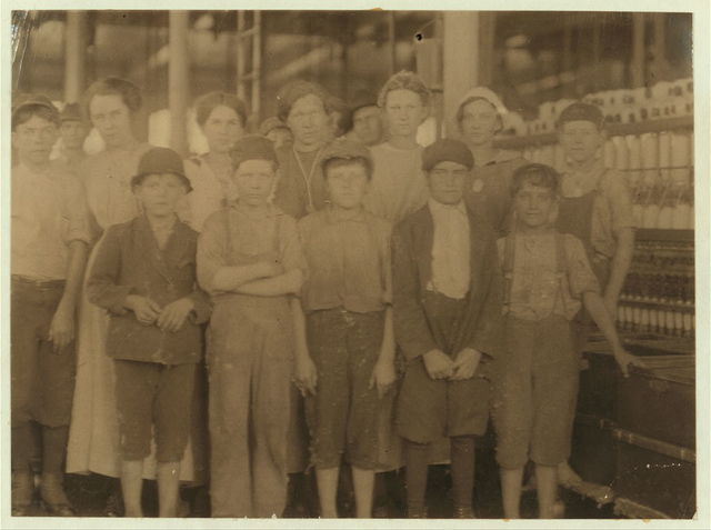 Group of workers in the Massachusetts Mills, Lindale, Ga. Photo taken at noon, April 12, 1913, while they were being paid off. During the days following this, I proved the ages of nearly a dozen of these children, by gaining access to Family Records, Life Insurance papers, and through conversations with the children and parents, and found these that I could prove to be working now, or during the past year at 10 and 11 years of age, some of them having begun before they were ten. Further search would reveal dozens more. (See Hine Report.) Massachusetts Mills, Lindale, Ga. Apr. 12, 1913.  Location: Lindale, Georgia / Photo by Lewis W. Hine.