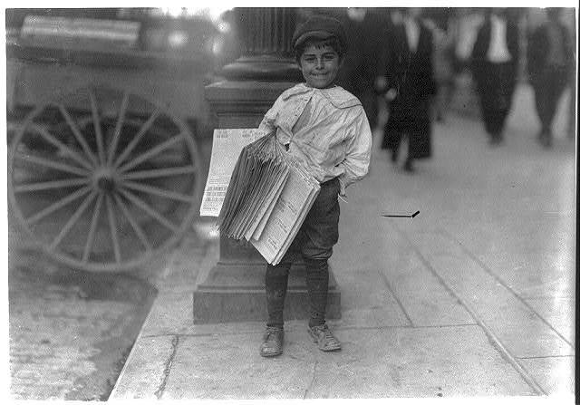"""Heiney""[?] one of Dallas' young news-boys. Many of them here.  Location: Dallas, Texas."