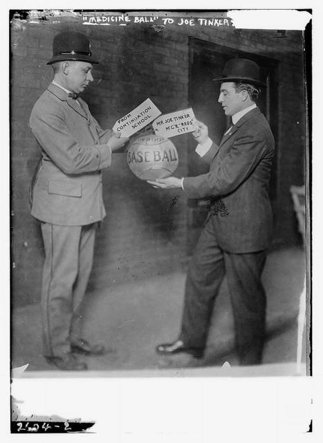 Joe Tinker receiving medicine ball sent by Continuation School 1913