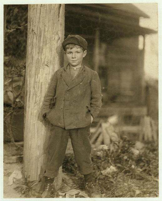 John Holland. Said he was 10 years old. Has had a regular job for some months rolling bobbins in the Deep River Mill. Been helping the father and brother a year.  Location: Randleman, North Carolina.