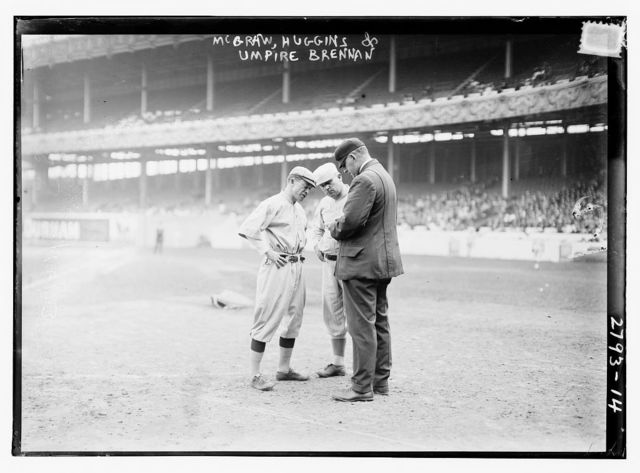 """[Managers John McGraw, New York NL, and Miller Huggins, St. Louis NL, with umpire William T. """"Bill"""" Brennan"""
