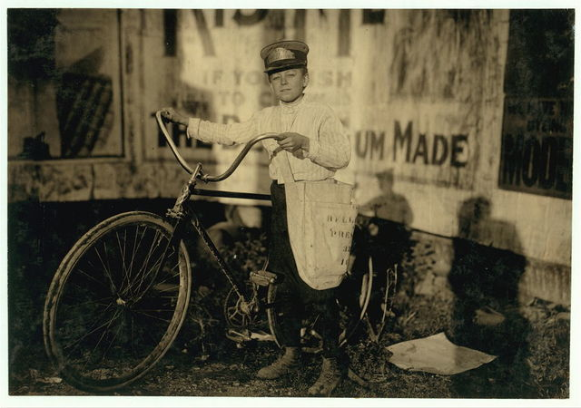 """Marion Davis, Messenger #21 for Bellevue Messenger Service. Fourteen years old. """"Been messenger, off and on, for two years. Not supposed to go to the Reservation under sixteen years, but I do just the same. The boss don't care and the cops don't stop me.""""  Location: Houston, Texas."""