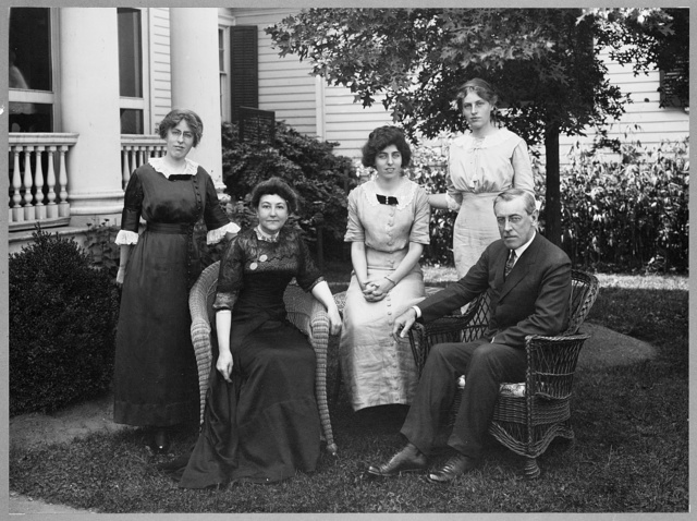[Mr. and Mrs. Woodrow Wilson seated outdoors with their three daughters standing behind them--(left to right) Margaret, Eleanor, and Jessie, in Cornish, New Hampshire]