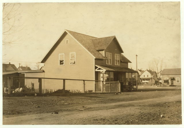 Outside view of the Mill School at the Merrimack Mills, tucked away upstairs over the store. Equipped with antique, dilapidated benches and chairs. The lessons begin at 6 [?] A.M. and last for six hours, and these children who attend in the morning go into the mill in the afternoon and vice versa for the required eight weeks, which the law specifies. Taking everything into consideration it shows what a travesty vocational guidance may become, and is in itself the best example of Dotheboys Hall I have ever seen, except that it is not half so practical as was Squeer's school. See Hine report.  Location: Huntsville, Alabama.