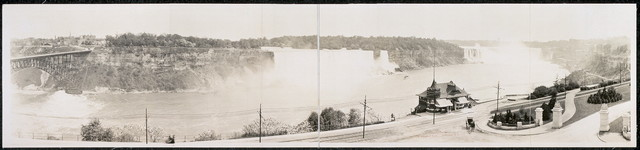 [Panoram view of Niagara Falls from Canadian side of river showing both American and Horseshoe Falls]