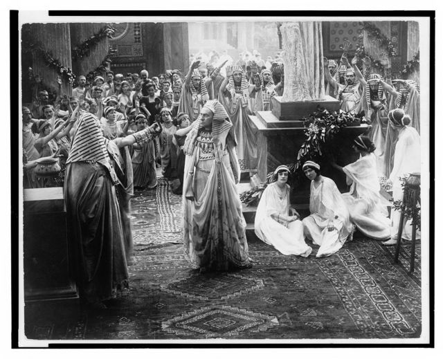 "[Scene from the silent film ""The last days of Pompeii"" showing priests and citizens worshipping a statue]"