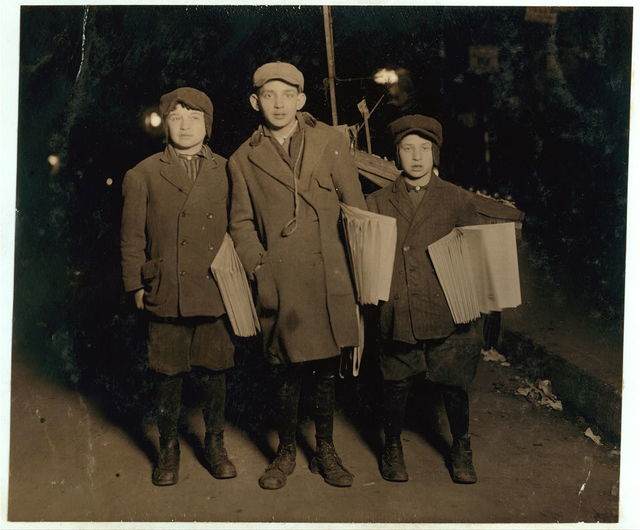 "Selling the ""Warheit"" - Jewish paper, at midnight, on Delancey Street. M. Brown - 247 Monroe Street, Age 10 - on right. H. Brown - 247 Monroe Street, Age 12 - on left. Scheer - 263 Stanton Street, Age 14 - centre.  Location: New York, New York (State)"