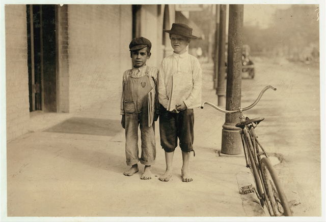 Sonny and Pete newsboys. One is six years old. They began at 6:00 A.M.  Location: San Antonio, Texas.