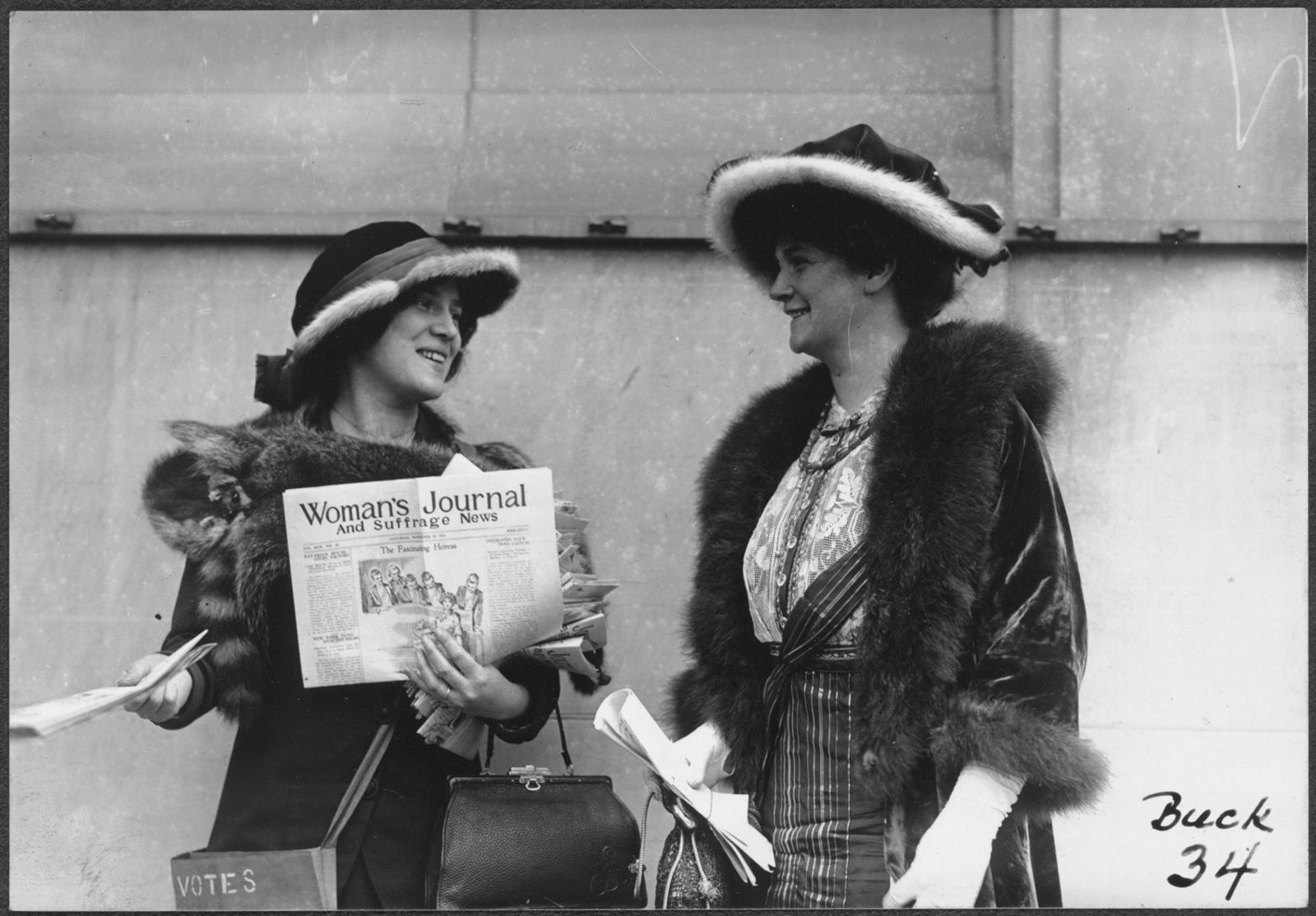 [Suffragist Margaret Foley distributing the Woman's Journal and Suffrage News]