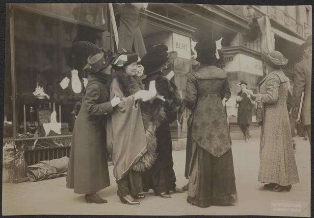 [Suffragists distributing hand bills advertising March 3, 1913, suffrage parade.]