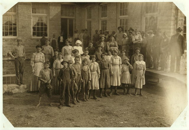 The whole force of workers in the cotton mills of Stevenson, Ala. Several of them are apparently under twelve, but I could not get the ages. Photo posed by the general manager.  Location: Stevenson, Alabama.