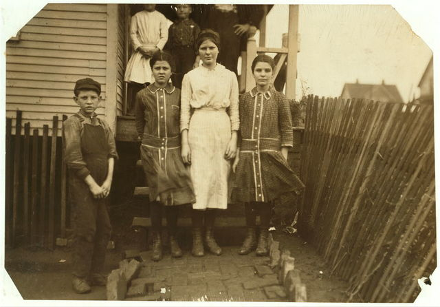 These four children of H.T. Thompson, 267 A Street all work in the Merrimack Mill. The youngest, a girl, has been there three years. See Hine report.  Location: Huntsville, Alabama.
