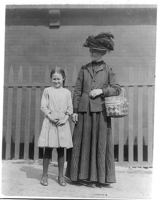 """""""Willie"""" McPherson, a 10 year old Helper, who totes dinners and helps her mother in Muscogee Mill, Columbus, Ga. """"She helps me a good deal."""" Sister went to work at 7 years. I saw several young helpers going to and from work at that mill.  Location: Columbus, Georgia."""