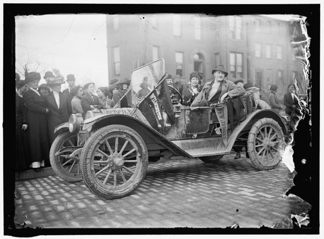 WOMAN SUFFRAGE. SCOUT CAR