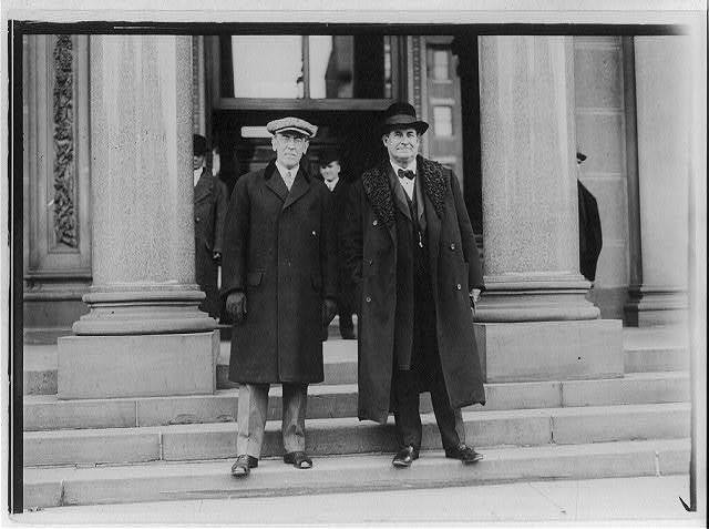 [Woodrow Wilson and William Jennings Bryan standing on steps in front of a building]