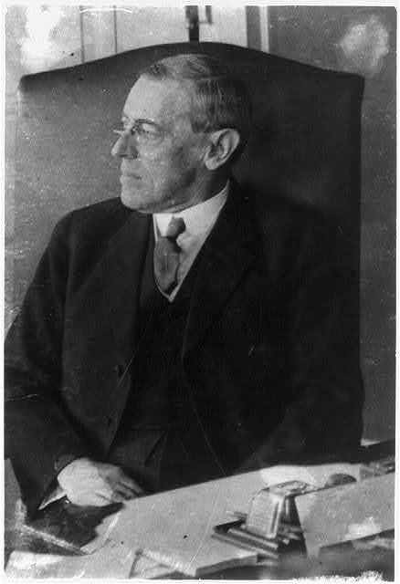 [Woodrow Wilson, half-length portrait, seated at desk, facing left, at one of his first cabinet meetings]