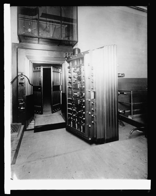 Bureau of Engraving & Printing. Twelve-ton steel door to vault containing distinctive paper on which U.S. and national bank notes and U.S. bonds are printed, [1914]