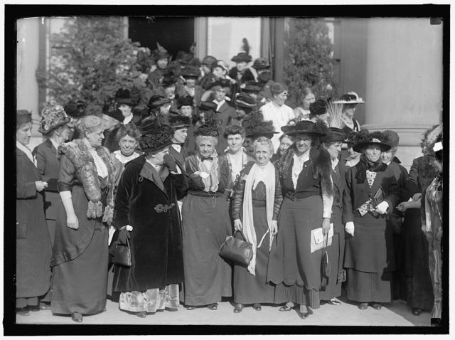 CONSTRUCTIVE PEACE GROUP: AT EXTREME LEFT, CHARLOTTE P. GILLMAN; NEXT MRS. C.C. CATT; DR. A.H. SHAW; MRS. HENRY WILLARD; MRS. ANNA G. SPENCER; MARION T. BURRITT; JANET RICHARDS. 2ND ROW, 2ND FROM LEFT, MRS. JULIUS KAHN; RIGHT, ROSALIE JONES; RIGHT, HALF WAY BACK, MRS. RICHARD BOECKEL