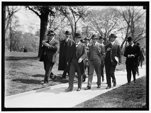 DANIELS, JOSEPHUS. SECRETARY OF THE NAVY, 1913-1921. WITH NEWSMEN