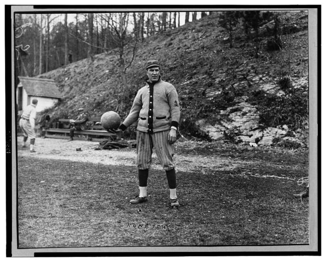 [Ed Konetchy, baseball player with the Pittsburgh Pirates, standing, while holding a medicine ball]