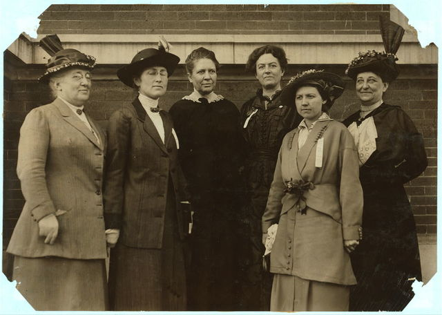 Factory Inspectors Past and Present. From left to right: Miss Ella Haas, State Factory Inspector, Dayton, O. Miss Mary Malone, State Inspector Ten-Hour Law, Delaware. Mrs. Florence Kelley, Chief State Factory Inspector of Illinois, 1893-97. Miss Jean Gordon, Factories Inspector, Parish of New Orleans, 1908. Miss Madge Nave, Factory Inspector, Louisville, Ky. Mrs. Martha D. Gould, Factories Inspector, Parish of New Orleans.  Location: New Orleans, Louisiana.