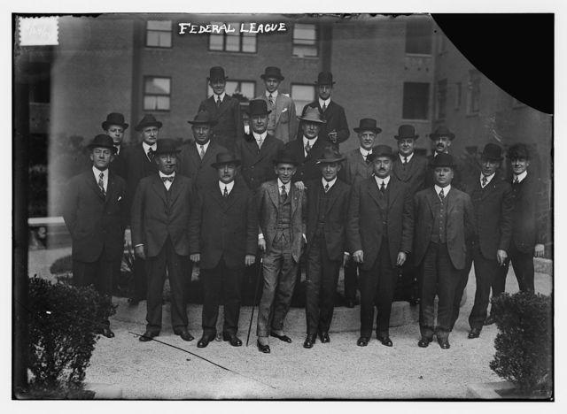 [Federal League Officials: (top row) Weeghman, W. Ward, Comstock; (middle row) L. Goldman, R. Ward, Steininger, Gilmore, G. Ward, Schleunes, Walker, Robertson, George, Carroll;(bottom row) Krause, Ball, H. Goldman, Mullen, Rickart, Hanlon, Gates (baseball)]