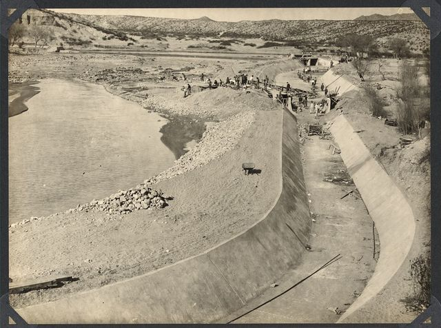 Franklin Canal, El Paso: Completing reconstruction of settling basin and concrete lining. Mexican dam is seen across river