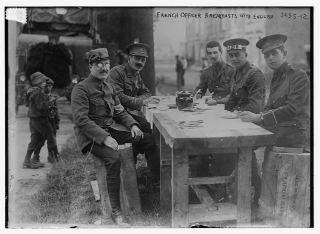 French Officer breakfasts with English