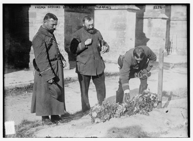 French Officers at graves of comrades