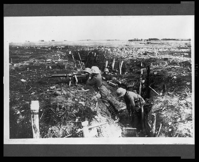 [German machine gunners in a trench]