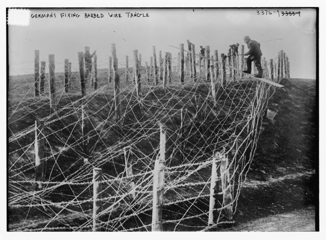 Germans fixing barbed wire tangle
